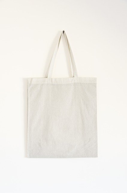 Cloth bag hung on white wall