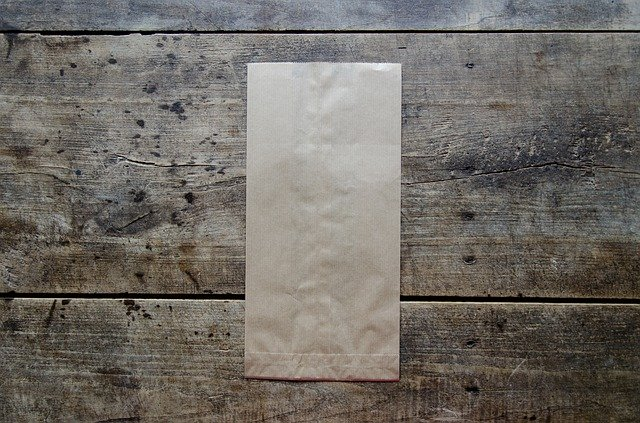 Brown paper back on wooden background