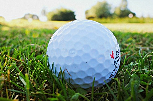 Golf ball in grass on golf course