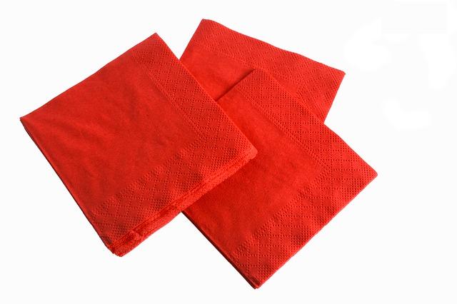 Red napkins on white background