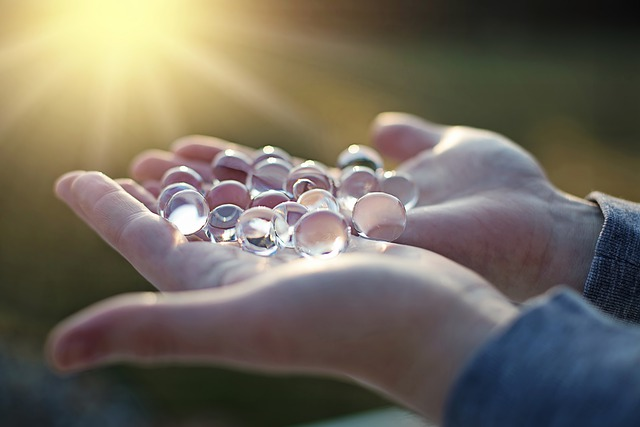 Water beads held in hands