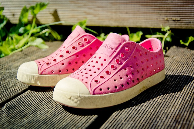 Pink crocs on wooden bench