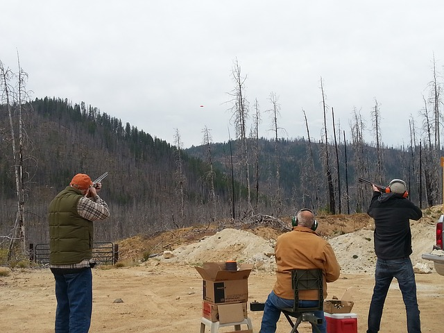 Shooters shooting clay pigeon out in forest