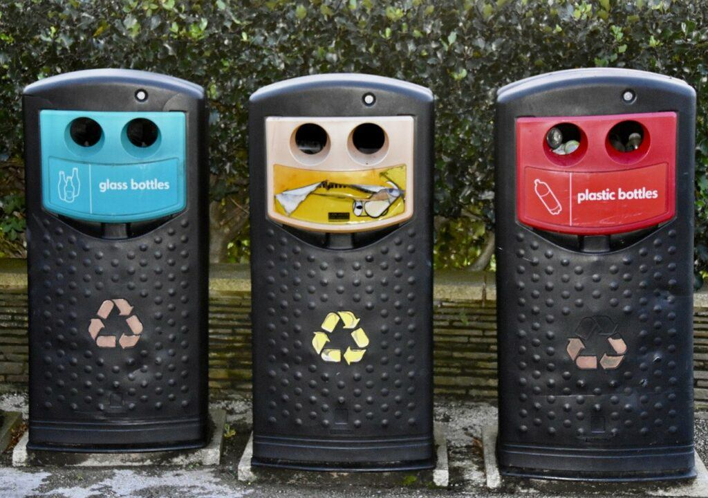 Recycling bins for plastic, paper, and glass