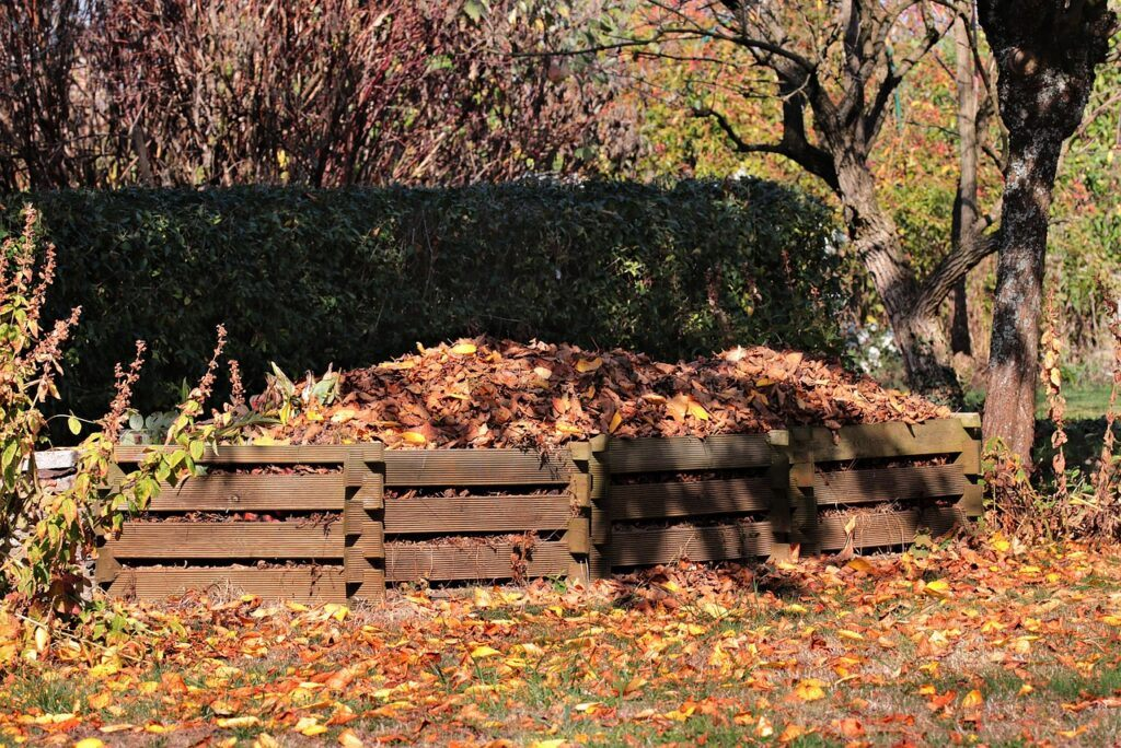 Compost piled filled with leaves