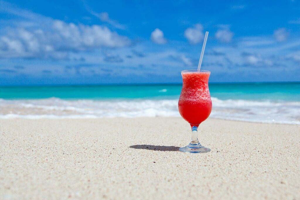 Glass beverage on beach