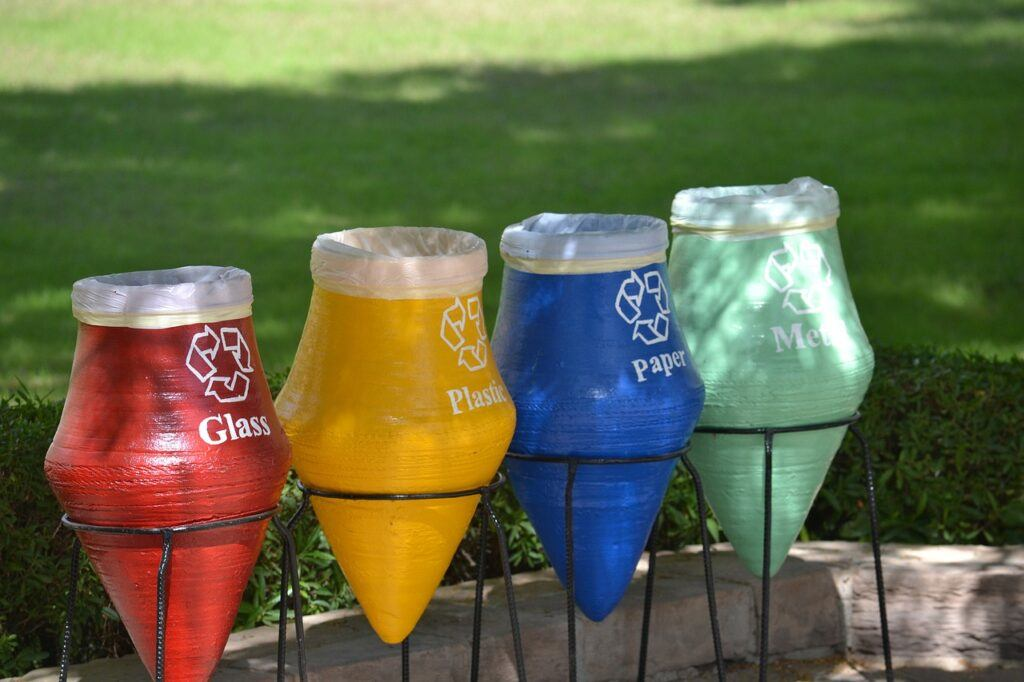 Glass, plastic, paper, and metal recycling jars