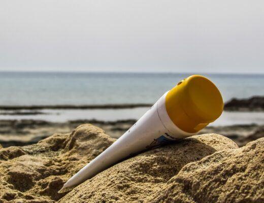 Bottle of Sunscreen on Sand Hill