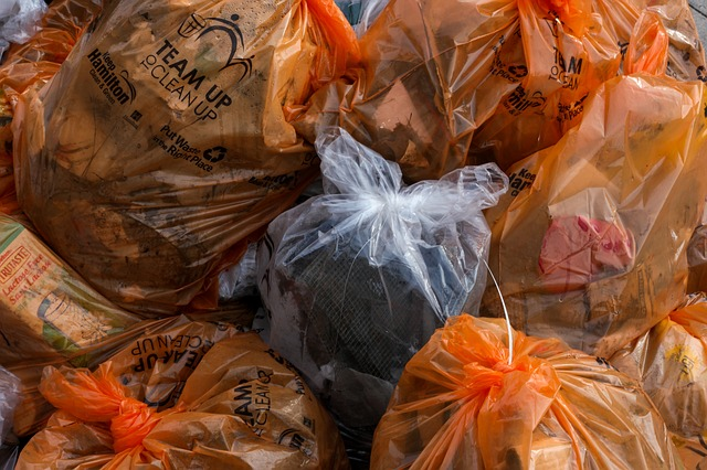 Fully used and tied up trash bags piled together.