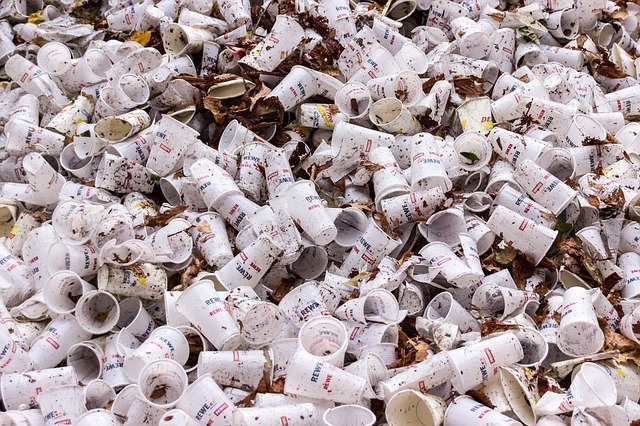 Plastic cups in garbage pile