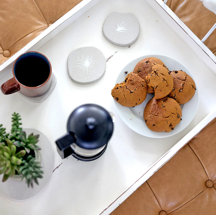 Platter of cookies and coffee sitting on Dorai River Rock Coasters