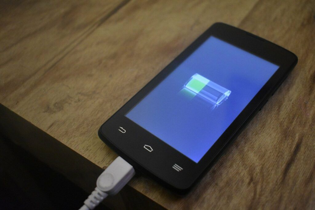 Phone charging on wooden table