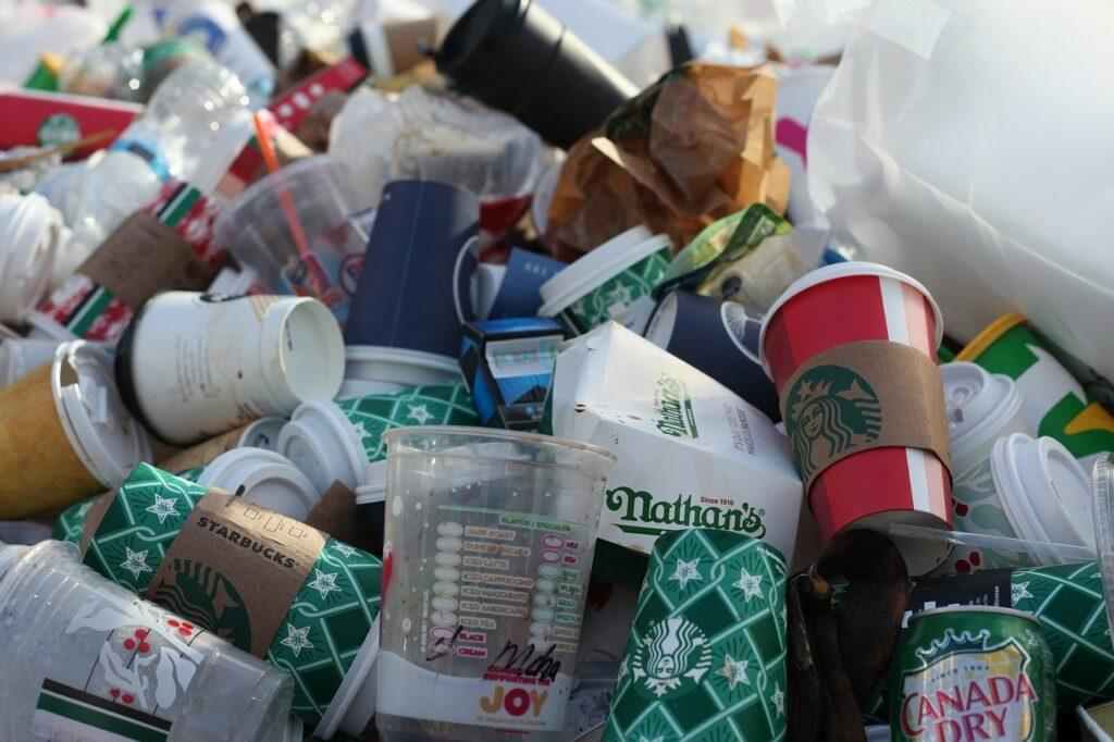 Disposable cups in trash pile