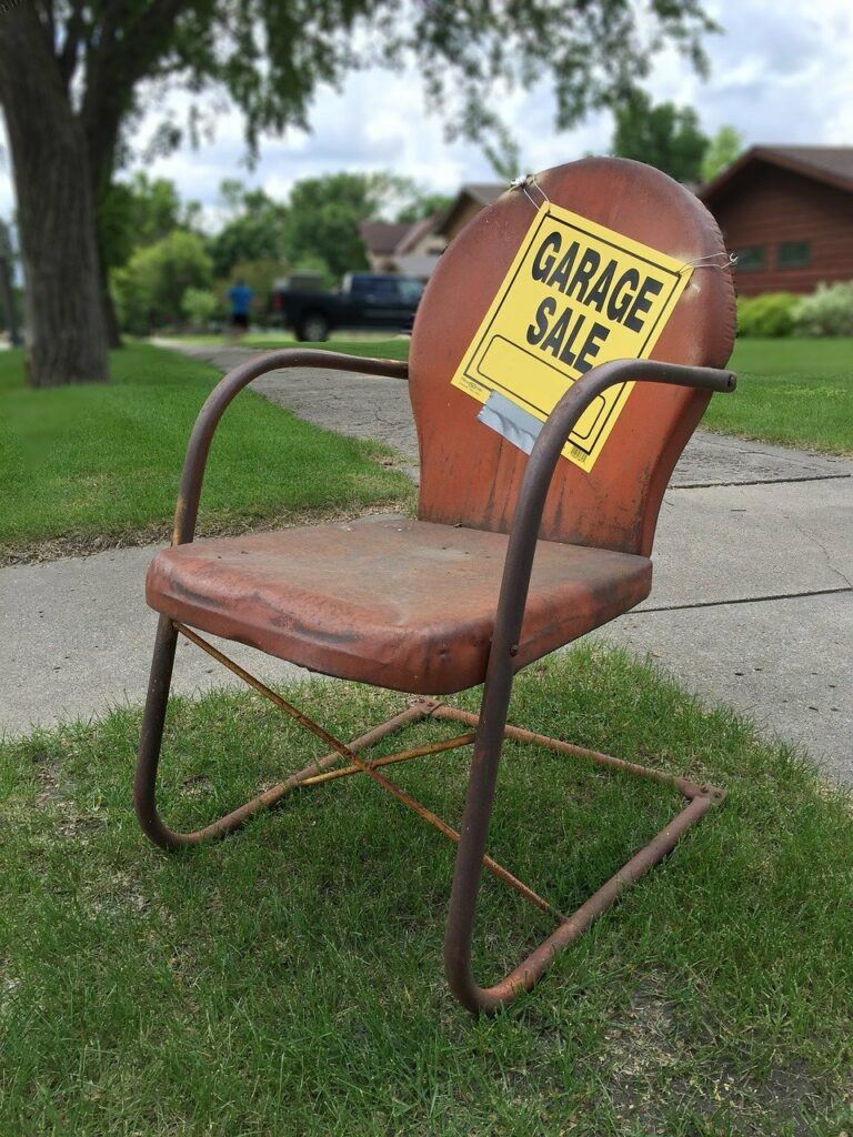 Garage sale sign on old chair