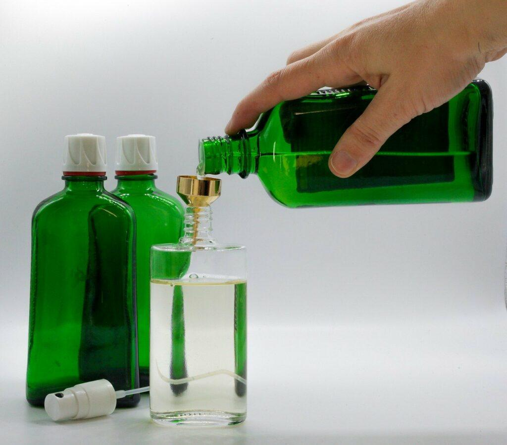 Filling a cologne/perfume bottle with oil